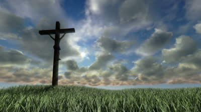 stock-footage-jesus-on-cross-meadow-and-timelapse-sunset