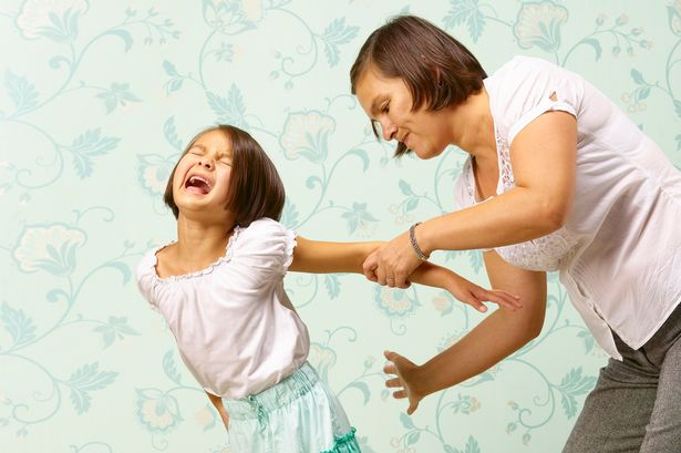 Woman+disciplining+her+daughter
